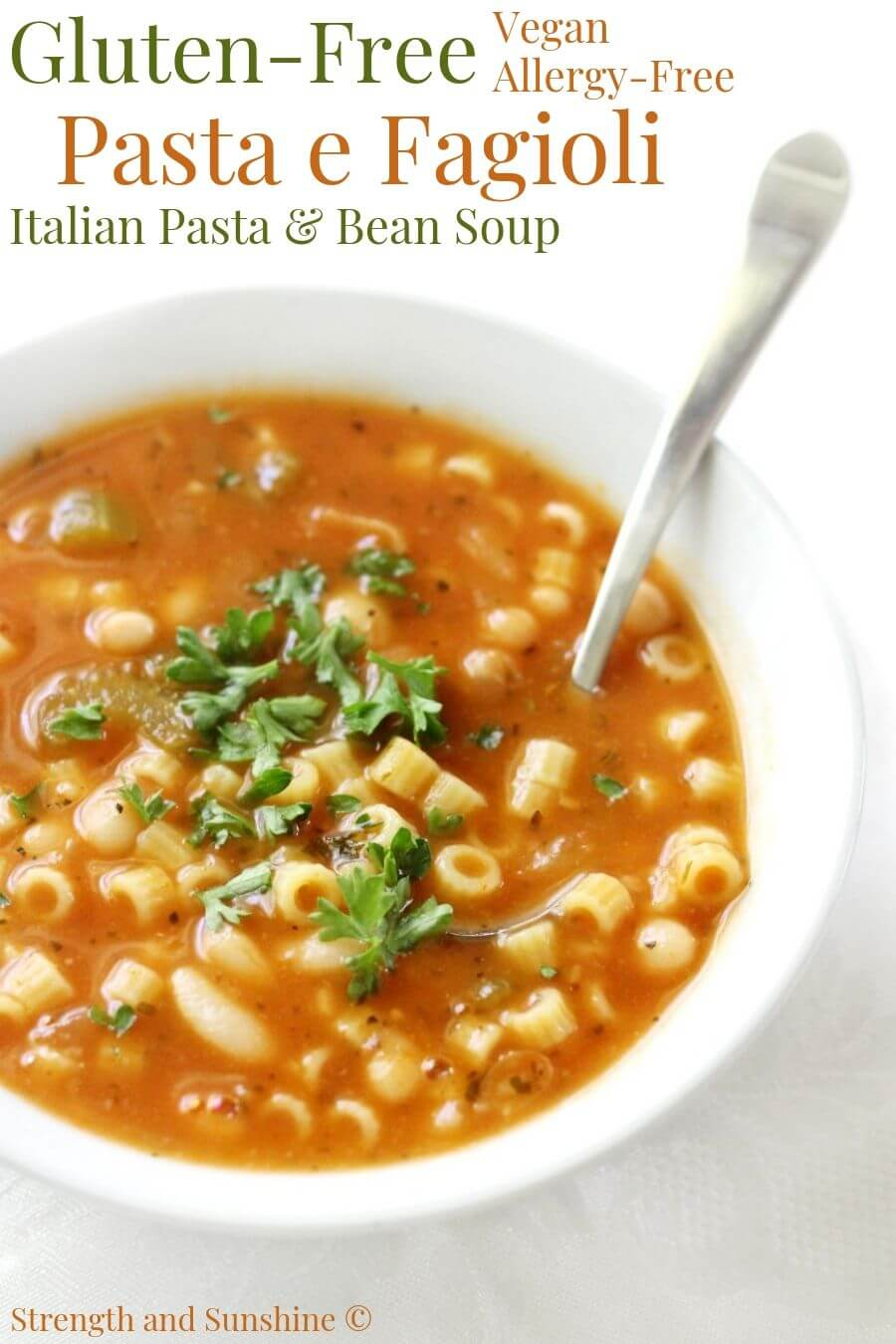 pasta e fagioli in white soup bowl with image text overlay