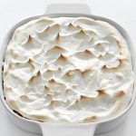 casserole dish of vegan sweet potato casserole with marshmallow