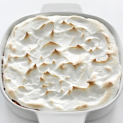 casserole dish of vegan sweet potato casserole with marshmallow