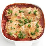 finished easy vegan eggplant parmesan in white casserole dish