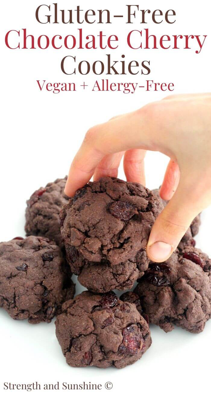 hand grabbing gluten-free chocolate cherry cookie under image text