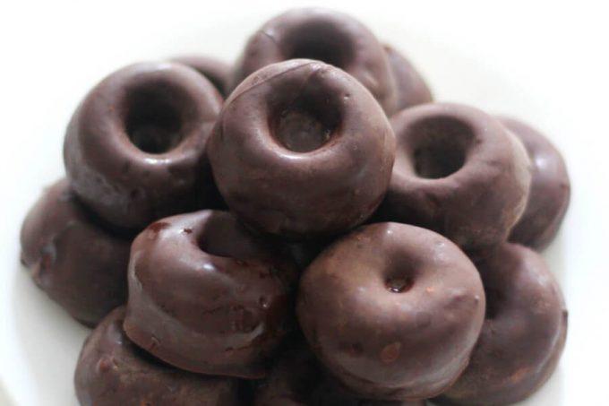 plate of gluten-free chocolate-covered mini doughnuts