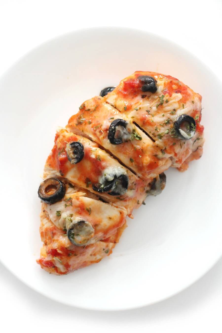 overhead view of dairy-free pizza chicken on white plate