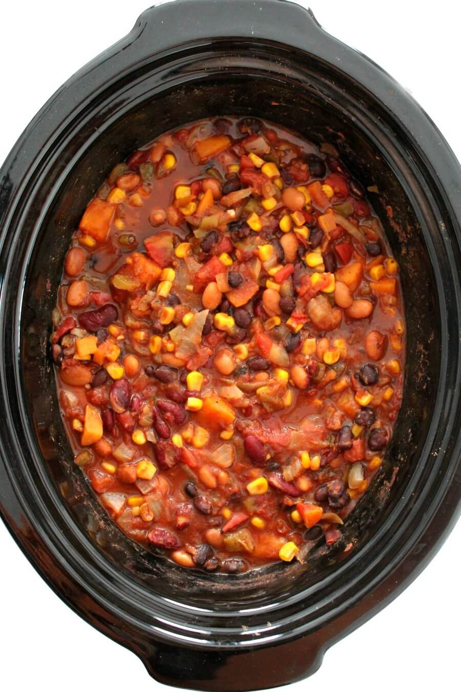 overhead view of slow cooker vegetarian chili in black crockpot