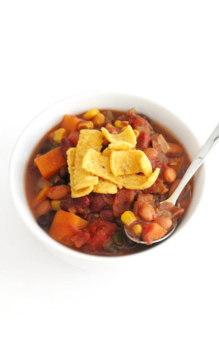 spoon and white bowl with slow cooker vegetarian chili