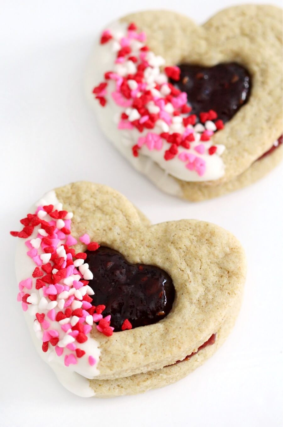 two gluten-free heart-shaped valentine cookies