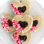 white plate piled with gluten-free valentine's day heart cookies