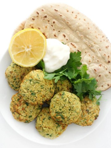 full plate of air fryer falafel with pita, lemon, yogurt, parsley