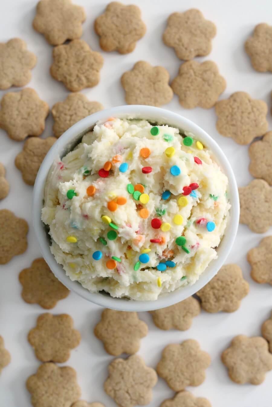 overhead view of vegan Dunkaroo dip with gluten-free cookies on table