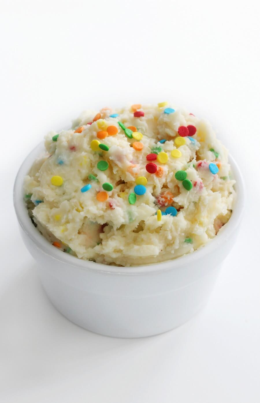 vegan dunkaroos dip with sprinkles in white bowl