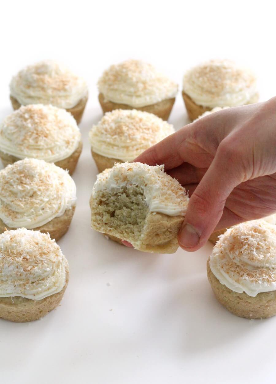 hand grabbing a gluten-free coconut cupcake