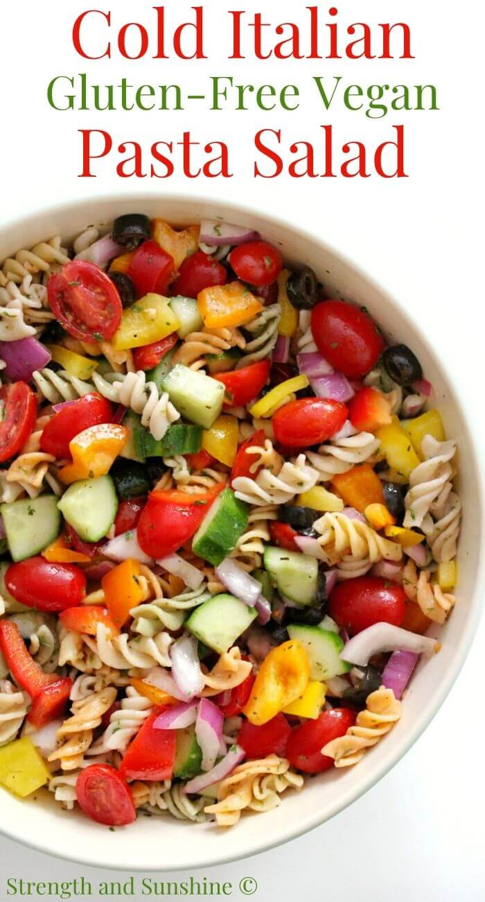 side overhead view of cold Italian pasta salad in bowl with image text