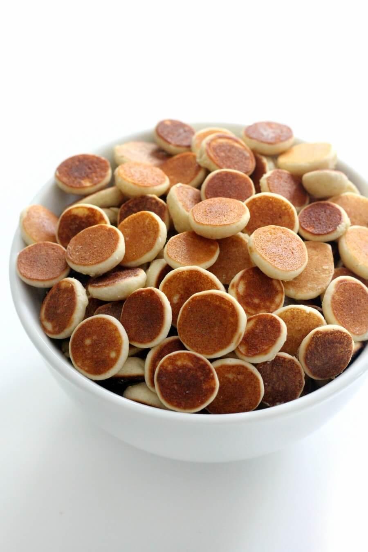 eye-level view of gluten-free pancake cereal in white bowl