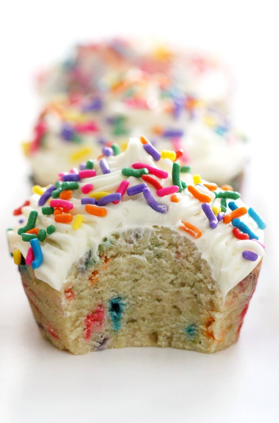 close-up of bitten gluten-free funfetti cupcake
