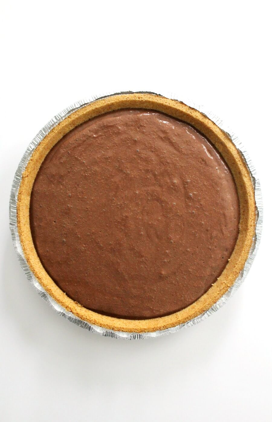 overhead view of chocolate pudding in gluten-free graham cracker crust