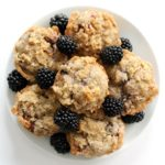 overhead view of full plate piled with gluten-free blackberry muffins with streusel topping