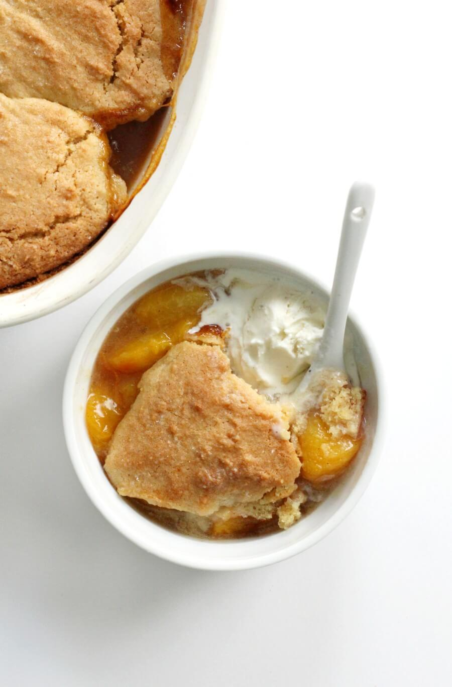 overhead view of gluten-free peach cobbler in bowl and casserole dish
