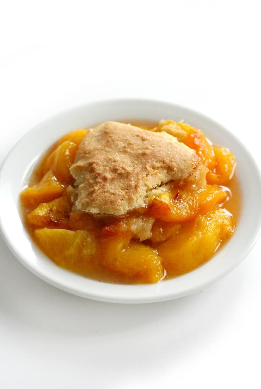single serving of gluten-free peach cobbler on white plate