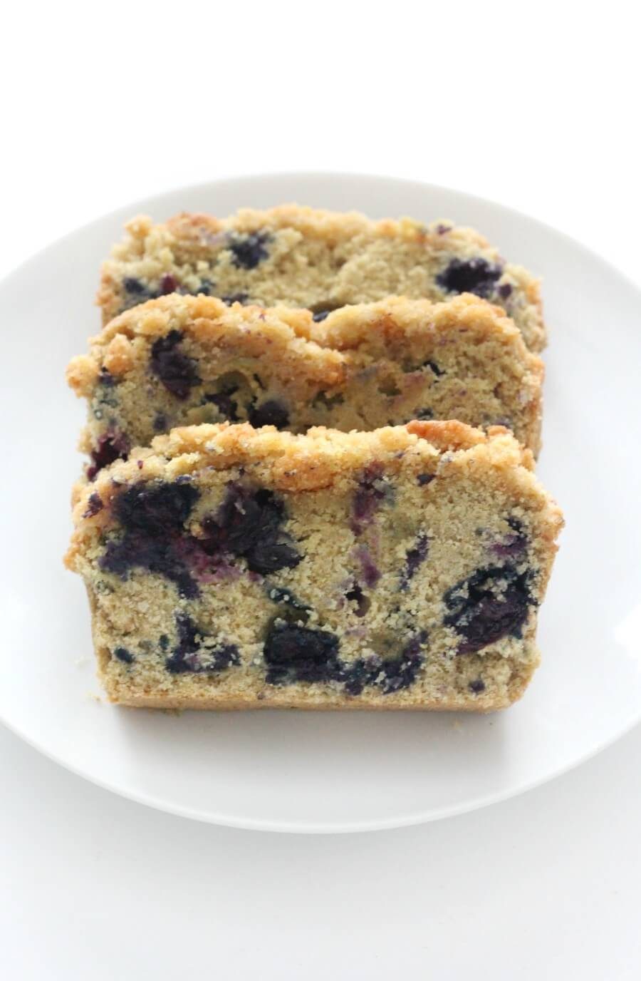 sliced gluten-free blueberry bread on centered white plate