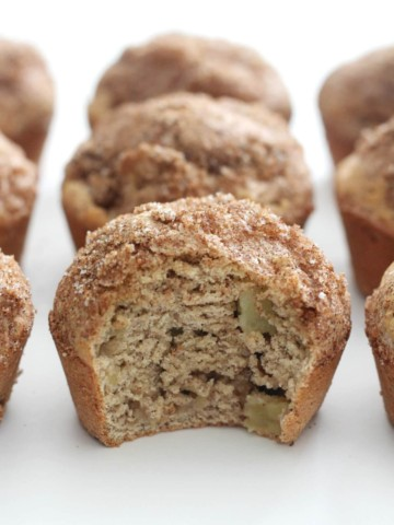 gluten-free apple cinnamon muffin with bite taken out
