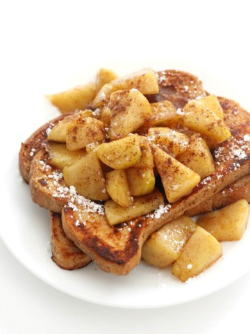 gluten-free apple cinnamon french toast on white plate