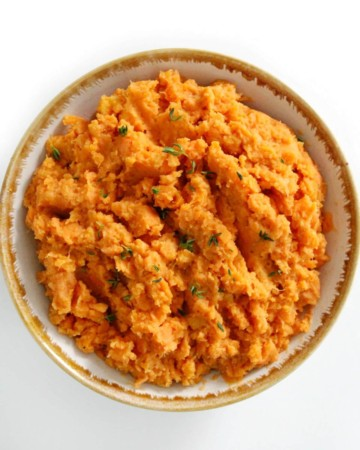 centered overhead image of vegan mashed sweet potatoes in bowl