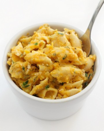 small white bowl with vegan butternut squash mac and cheese with fork