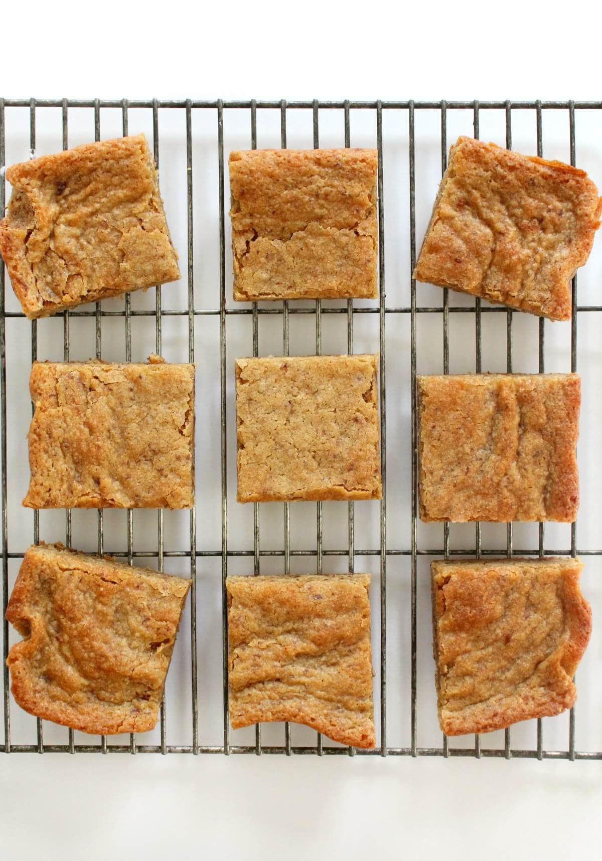 9 cut maple blondie squares cooling on a wire rack