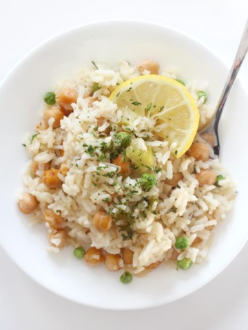 white plate with serving of lemon chickpea and rice casserole