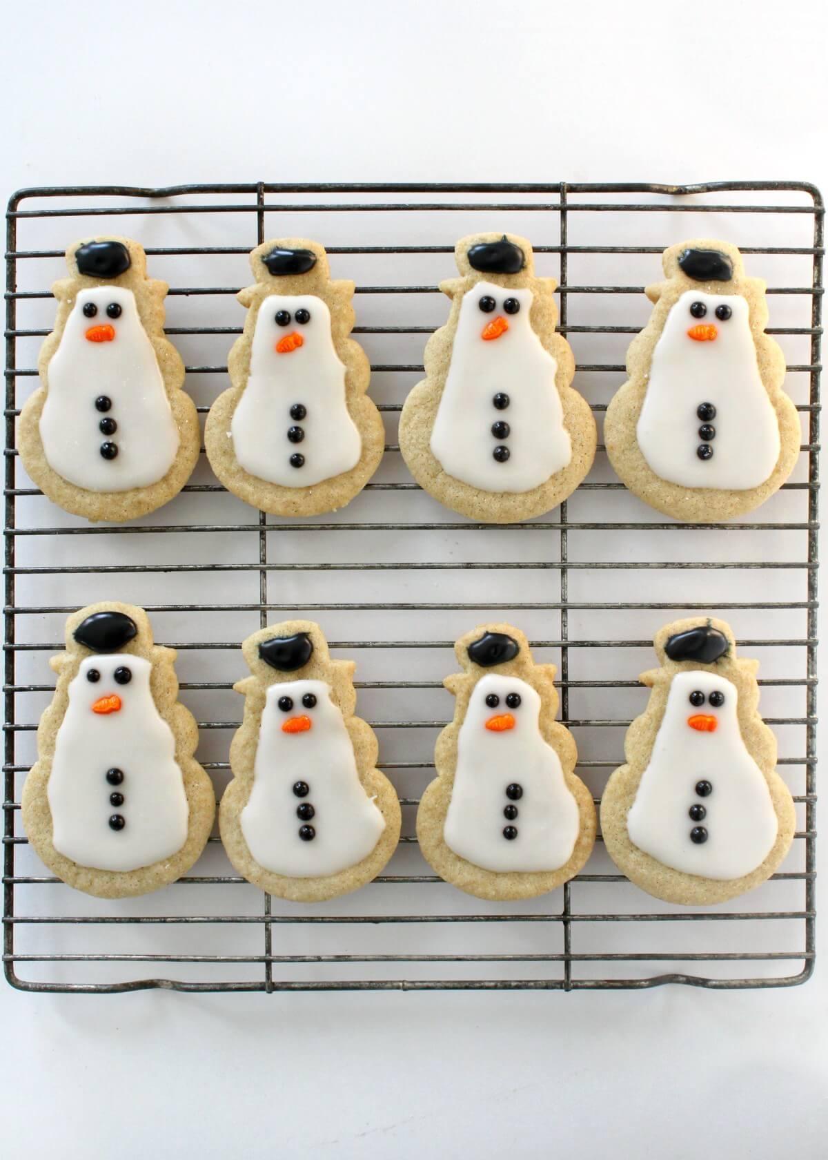 gluten-free snowman sugar cookies on wire rack