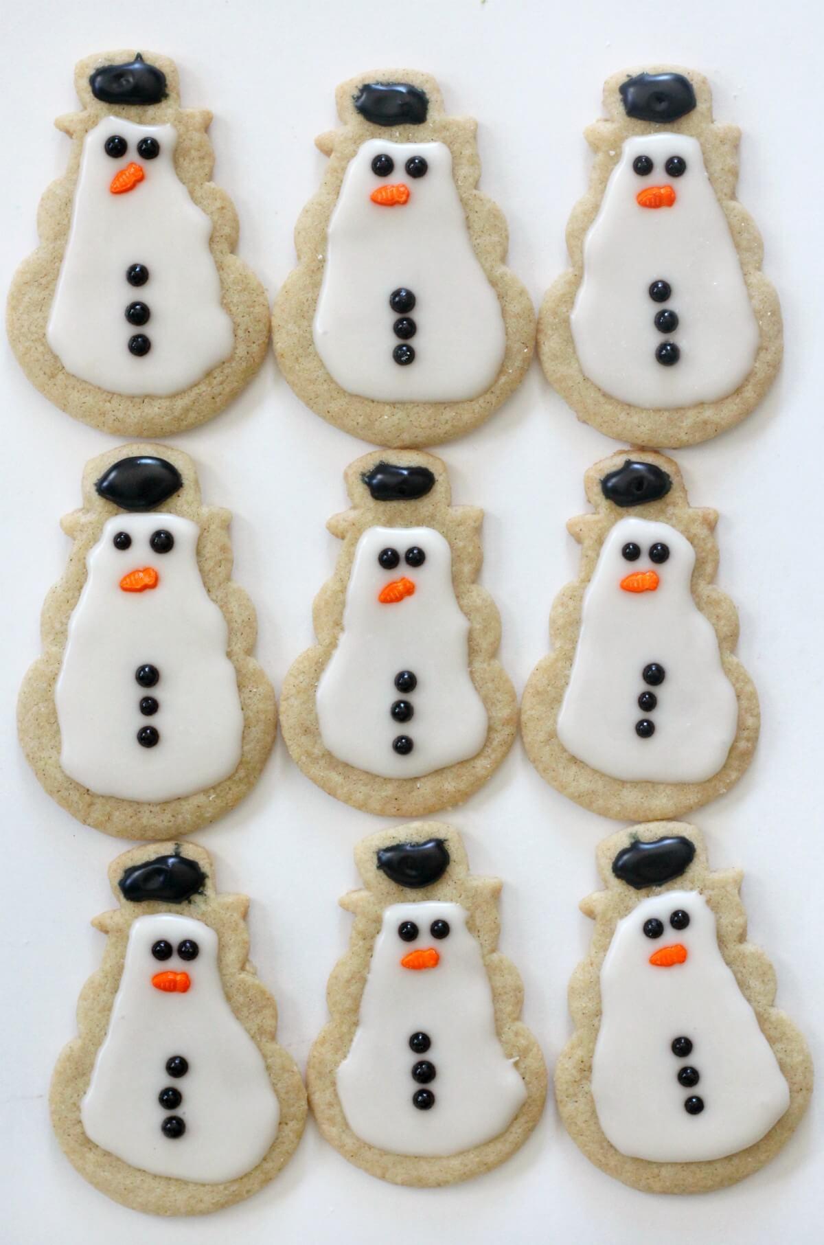 nine gluten-free snowman sugar cookies