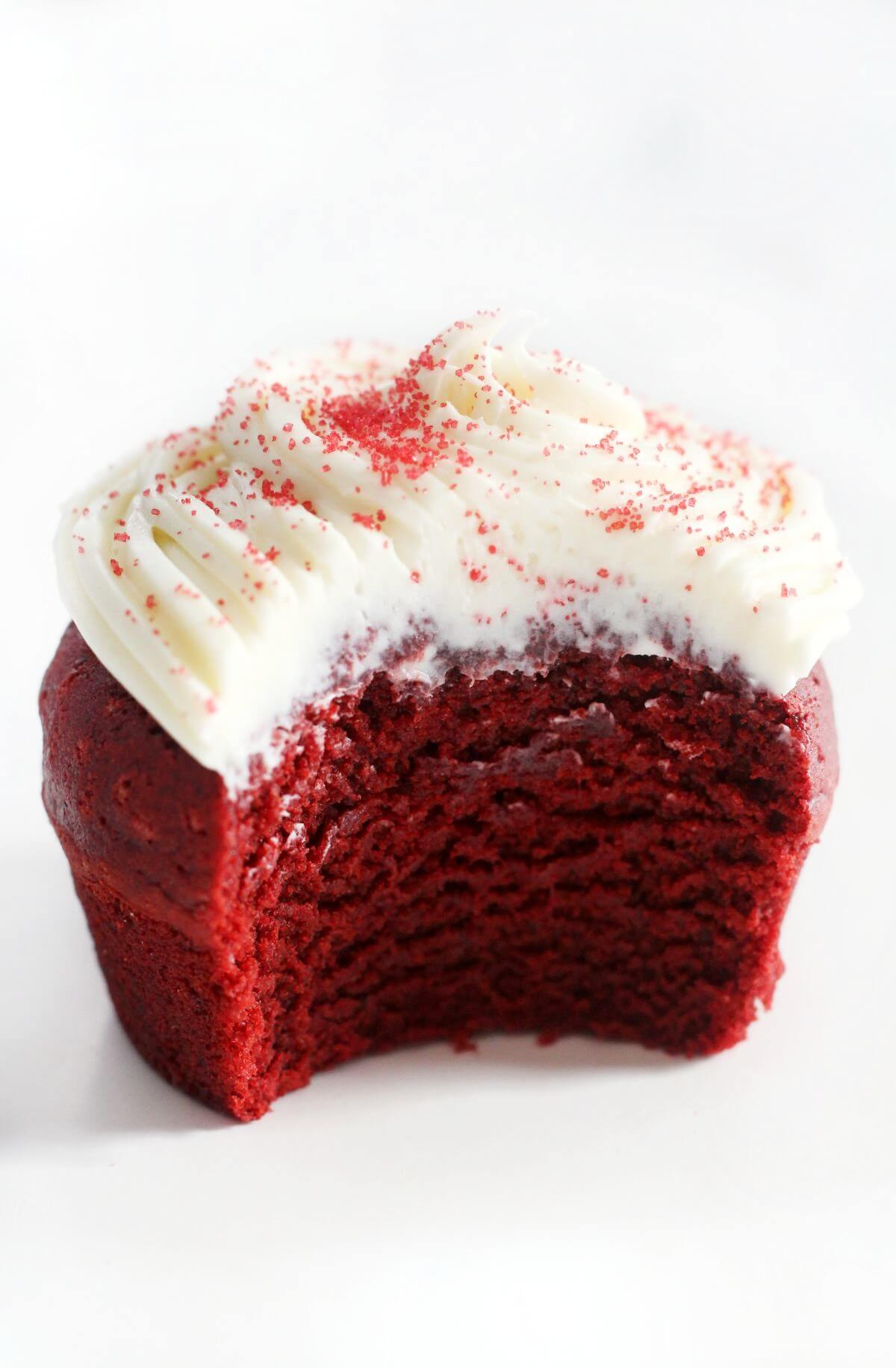 single gluten-free red velvet cupcakes with bite taken out