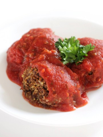 high-protein vegan meatballs with sauce on white plate