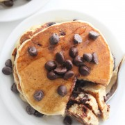 overhead view of vegan and gluten-free chocolate chip pancakes on a plate