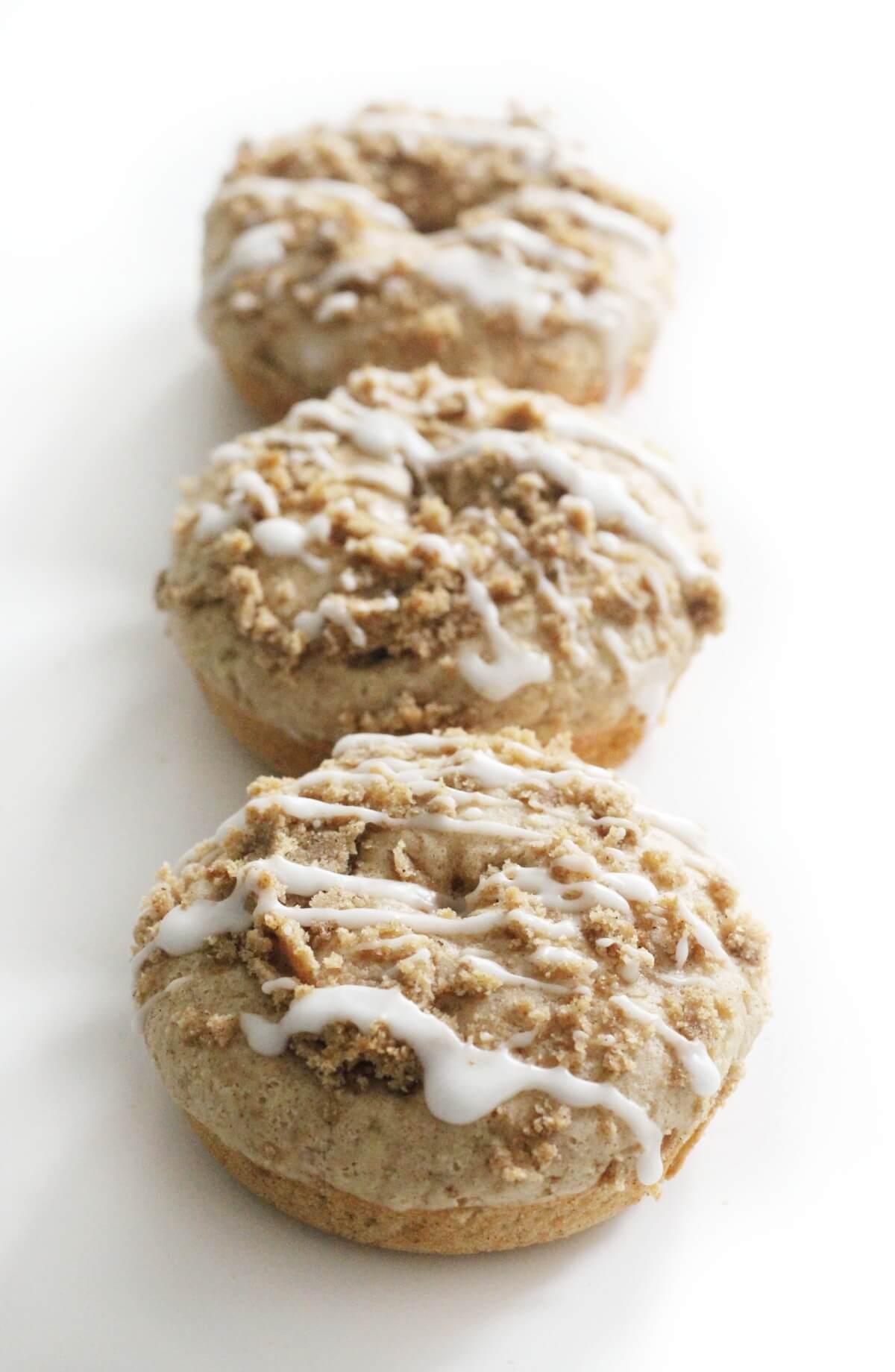 three gluten-free coffee cake doughnuts lined up