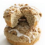 two gluten-free coffee cake doughnuts stacked