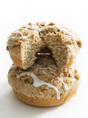 two gluten-free coffee cake doughnuts stacked