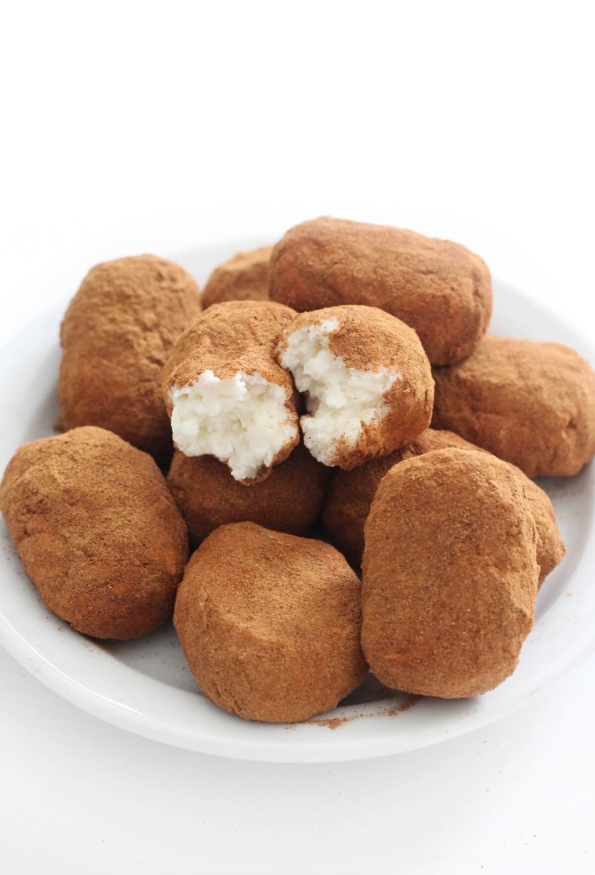 centered white plate with broken open irish potato candy