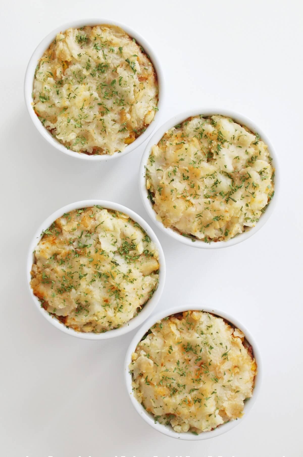 overhead view of four vegan lentil shepherd's pies in ramekins