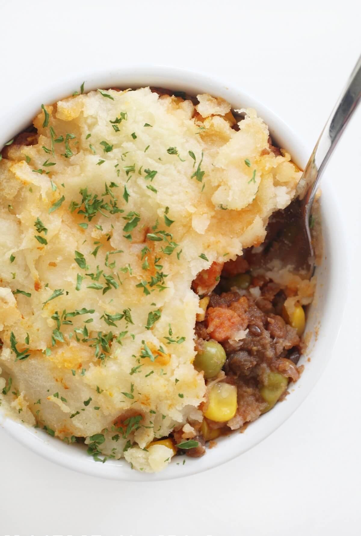 overhead close-up of vegan lentils shepherd's pie in a ramekin