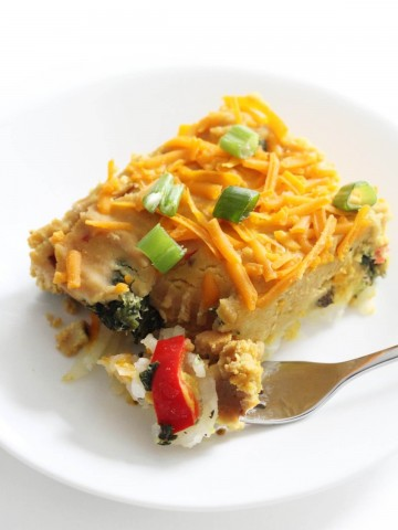 forkful of vegan breakfast casserole on white plate
