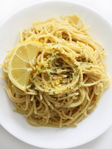 overhead view of vegan pasta al limone on white plate