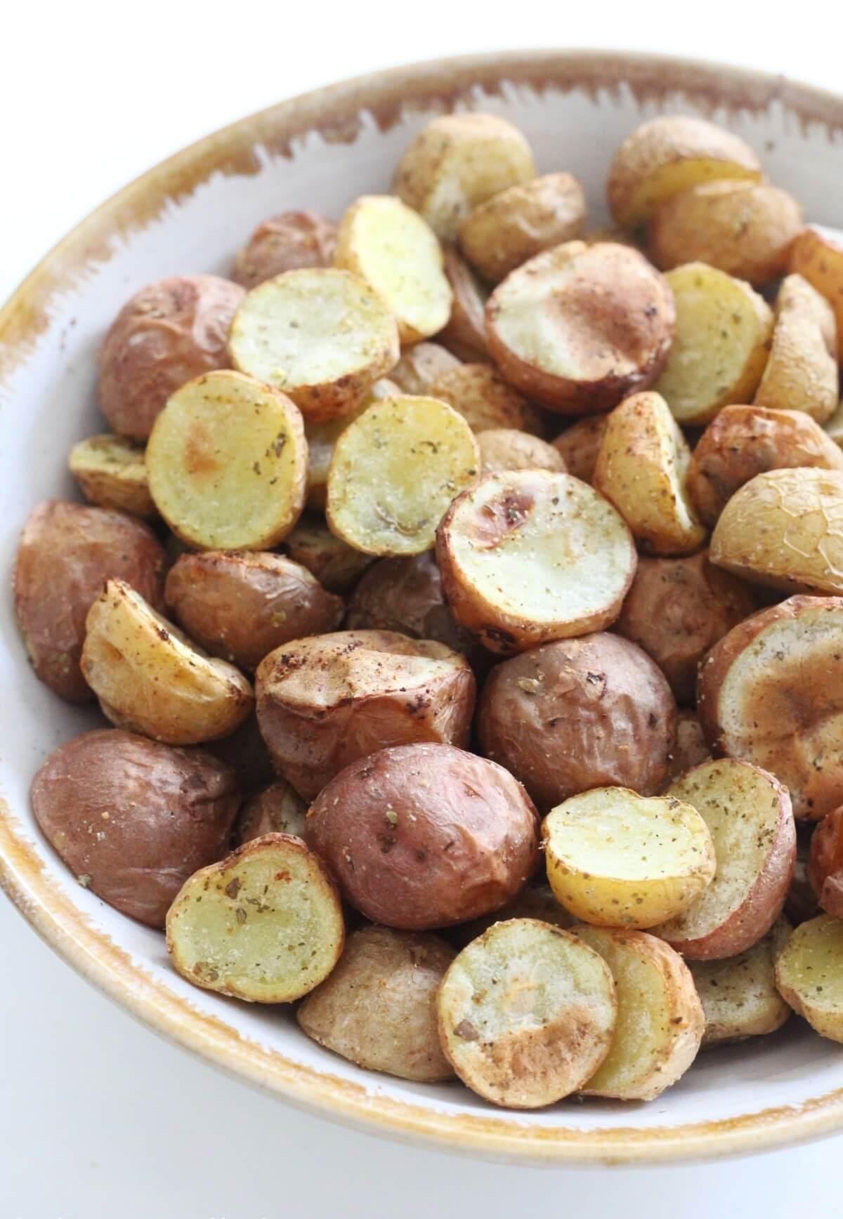 half a bowl full of crispy air fryer baby potatoes