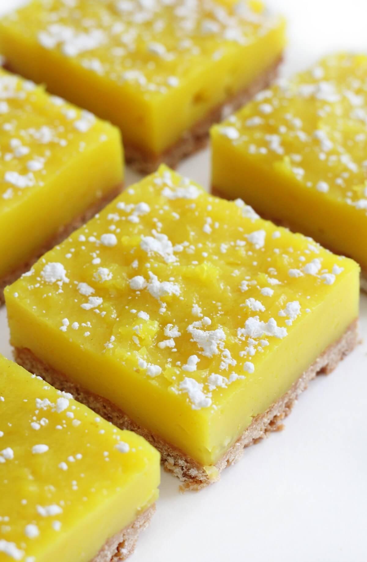 close up of cut square of vegan lemon bars