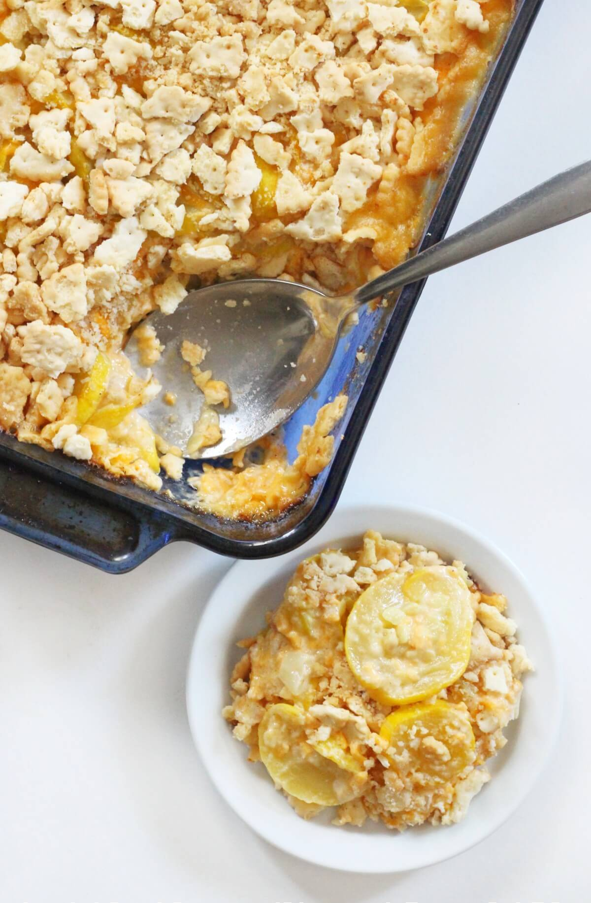 vegan southern squash casserole in baking dish and plated serving