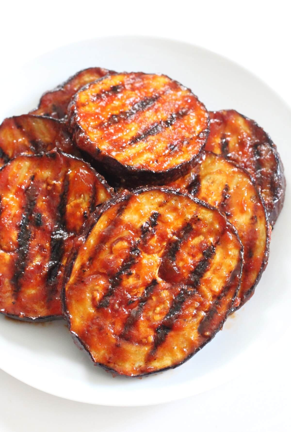 bbq grilled eggplant slices on plate