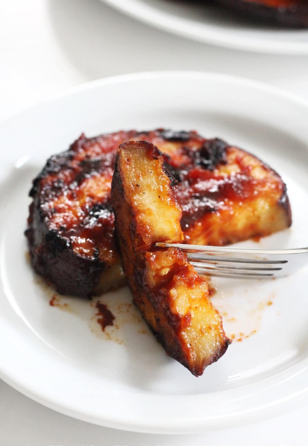 inside slice of bbq grilled eggplant with fork