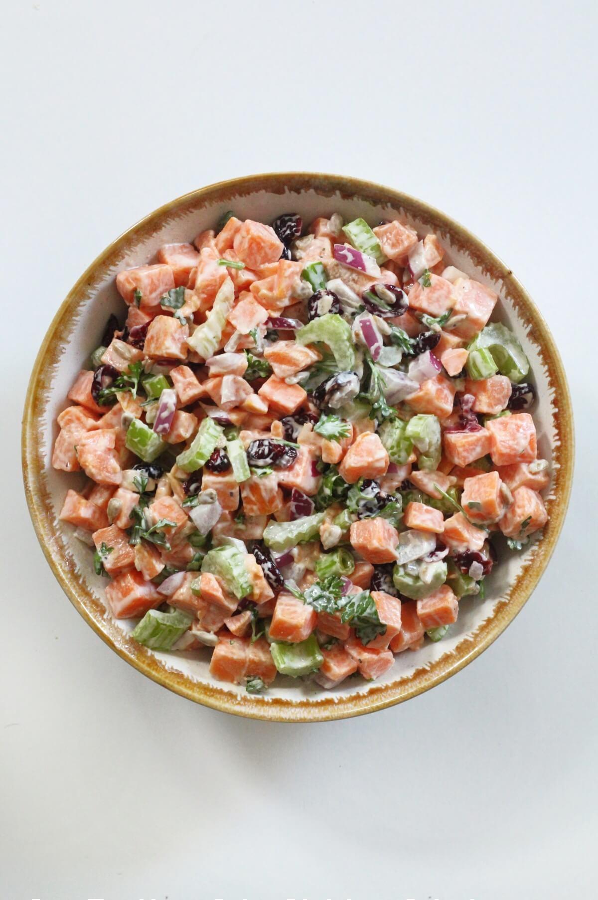 overhead view of serving bowl of sweet potato potato salad