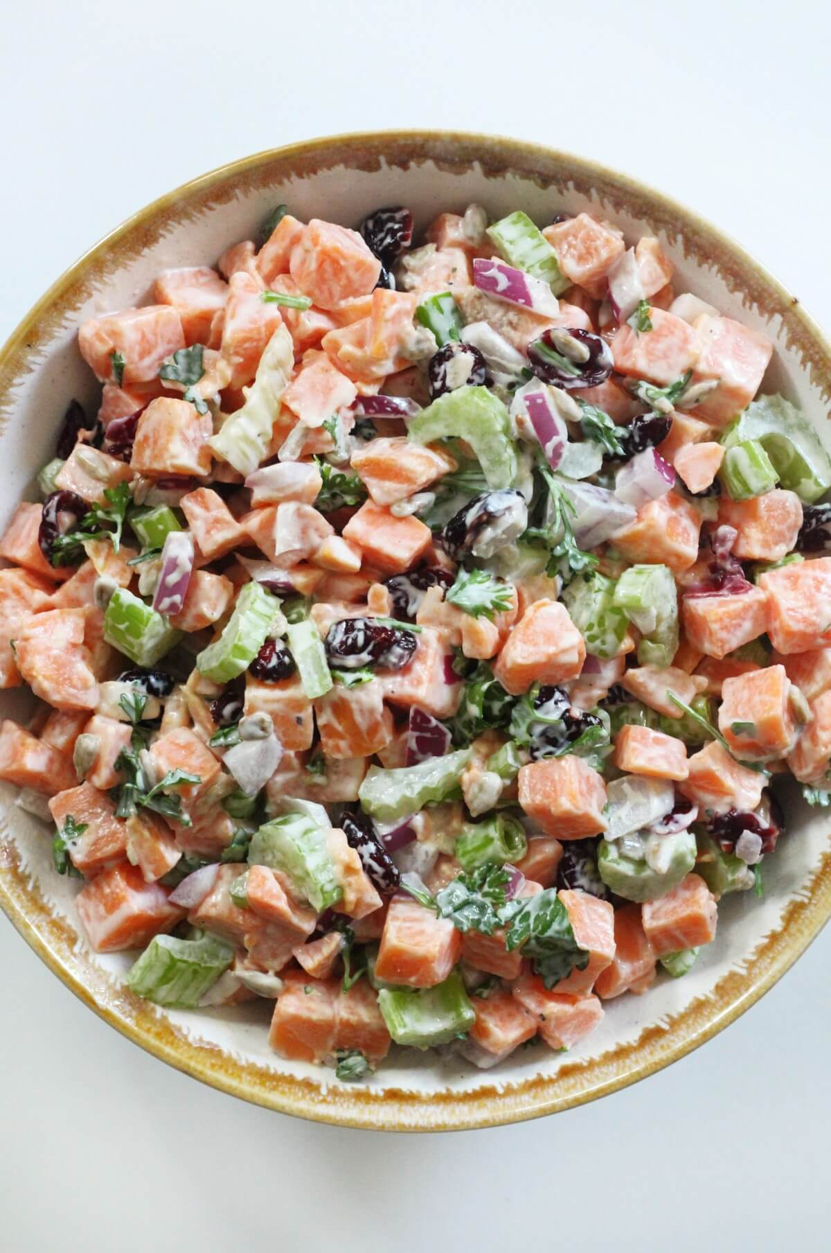 close up of sweet potato potato salad in serving bowl