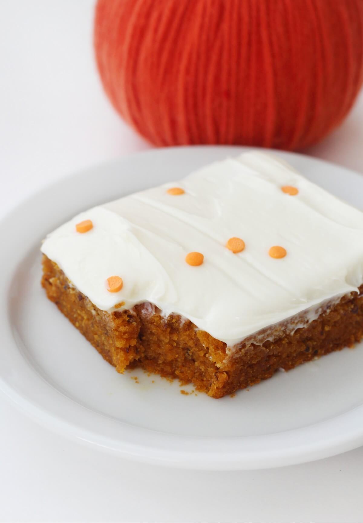 slice of pumpkin cake with pumpkin decoration